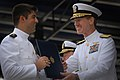 US Navy 110527-N-OA833-012 Vice Adm. Michael Miller, superintendent of the U.S. Naval Academy, congratulates a newly commissioned graduate.jpg