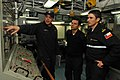 US Navy 110608-N-NL541-024 Gas Turbine Mechanic Fireman Jason Lindstrom, assigned to the guided-missile frigate USS Thach (FFG 43), explains the da.jpg