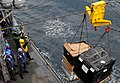 US Navy 110918-N-BC134-163 Sailors aboard the guided-missile cruiser USS Bunker Hill (CG 52) guide pallets of supplies onto the ship during a reple.jpg