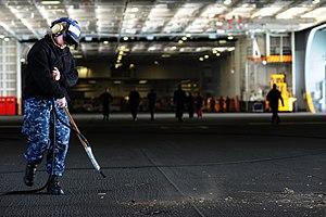 US Navy 120124-N-XE109-014 Aviation Boatswain's Mate Airman Danielle M. Jones cleans the hangar bay of the aircraft carrier USS George H.W. Bush (C.jpg