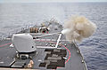 US Navy 120127-N-ZZ999-123 The guided-missile destroyer USS John S. McCain (DDG 56) fires exercise rounds from its MK-45 five-inch gun system durin.jpg