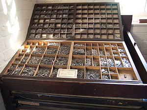 Letter case - Divided upper and lower type cases with cast metal sorts.