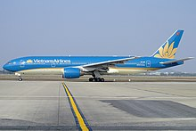 Vietnam Airlines Boeing 777-200ER in new livery at Hanoi.jpeg