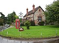 Village green, village sign and village hall - geograph.org.uk - 950988.jpg