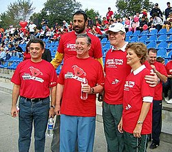 Vlade Divac (rear, center) in 2005, at an event for World Heart Day