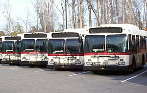 Transportation in Hampton Roads - A line of WAT transit buses equipped with 2-way radios, wheelchair lifts and bike racks are seen ready for service at the Williamsburg Bus Facility on U.S. Route 60 in James City County, Virginia.