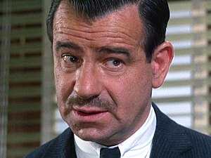 Screenshot of Walter Matthau from the film Charade