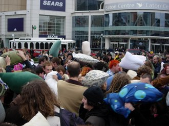 Flash mob - Flash mobs, like this pillow fight flash mob in Downtown Toronto (2005), are designed to surprise passers-by.