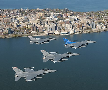 The skyline of Madison, with Wisconsin ANG F-16 jet fighters in the foreground WiscANG-F16-Madison-Skyline.jpg