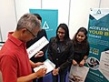 YB Tony Pua signing the token of appreciation for Trader Malaysia, signed at PJ Startup Festival.jpg