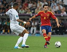 Yann M'Vila and Xavi Spain-France Euro 2012.jpg