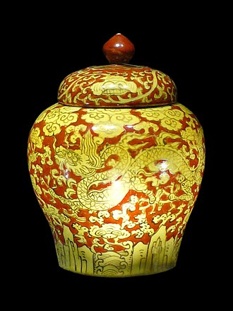 Chinese ceramics - Covered red jar with dragon and sea design from the Jiajing period (1521–1567) in the Ming dynasty