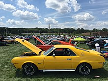 Stock And Customized AMXs At An American Motors Owners Association Meet