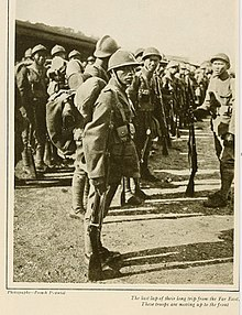 Old newspaper clipping of Asian soldiers