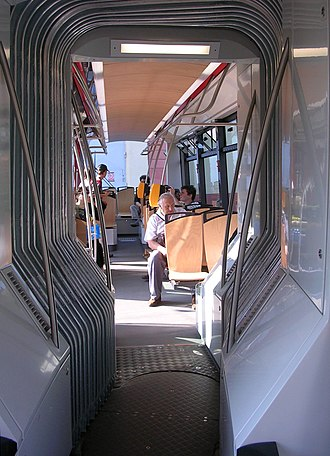 Articulated vehicle - Interior of an articulated tram, showing the pivoting floor and concertina gangway connection.