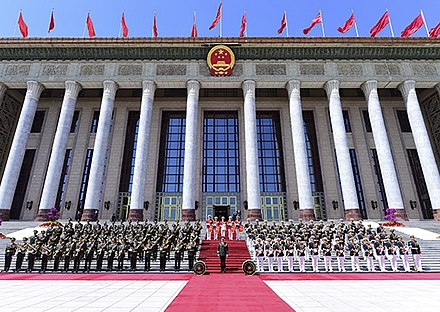The Central Military Band of the People's Liberation Army of China at the Great Hall of the People. The band is a common performer of the military anthem of the PLA at ceremonial protocol events. Orkestr Narodno-osvoboditel'noi armii Kitaia.jpg