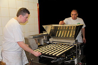Éclair - Bakers in Belgium using a machine to make éclairs