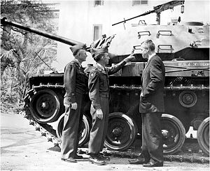 124th Infantry Regiment (United States) - Lt. Col. Ralph C. Davis (Battalion Commander) and Capt. Russell W. Buckhalt (Alpha Co. Commander) brief Gov. LeRoy Collins on an M-41 tank in front of the Capitol in 1956.