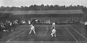 1897 Wimbledon Championships - Gentlemen's Doubles final at the 1897 Wimbledon Championships. Players shown are, at the near side, Reginald Doherty (left) and Laurence Doherty (right) and at the far side Herbert Baddeley (left) and Wilfred Baddeley (right).