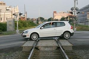 VW Golf GTi crossing the railroad in Durham