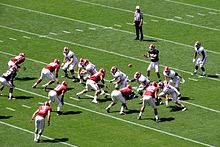 American football players in motion during a play.