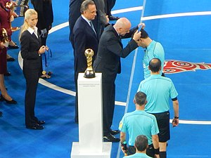 Milorad Mažić - Mažić and his assistances are receiving their awards after the final match of 2017 Confederations Cup