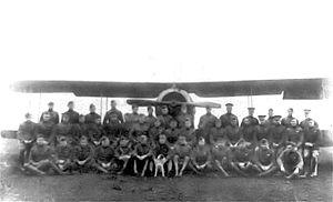 258th Aero Squadron - 258th Aero Squadron (with its mascot) in front of a squadron Salmson 2A2, Manonville Airdrome, France, November 1918