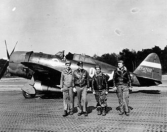 """RAF Goxhill -  Sergeant Elwin D. Phillips, Lieutenant Sidney Hewitt, Staff Sergeant Michael Yahawk and a colleague, of the 361st Fighter Squadron, 356th Fighter Group stand with Hewitt's P-47 Thunderbolt (QI-F, serial number 42-74702) nicknamed """"Clarkie"""" at Goxhill, 1943."""