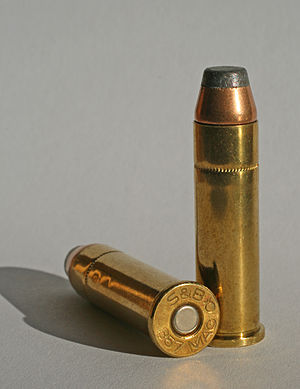 Centerfire ammunition -  Two rounds of .357 Magnum, which is a centerfire cartridge. Notice the circular primer in the center of the cartridge.