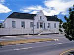 The designer of the Drostdy building was M L Thibault, the well-known architect. Construction started in 1804, was completed in 1810. Today the Drostdy forms part of the historic core of Uitenhage. Type of site: Drostdy.