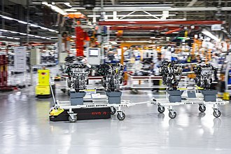 Automated guided vehicle - Example of AGV carrying trolley in a warehouse