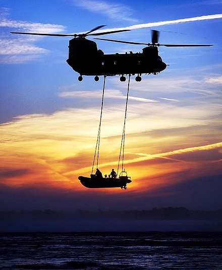 A Royal Marine RIB 'Underslinging', from an RAF Chinook as a method of quick extraction and insertion of waterborne personnel