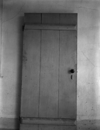 A batten door-the battens are the horizontal pieces which hold the door together.