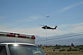 A U.S. Army UH-60 Black Hawk helicopter, bottom, assigned to the Colorado Army National Guard provides firefighting assistance for the Black Forest Fire in El Paso County, Colo., June 12, 2013 130612-Z-WF656-025.jpg