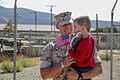 A U.S. Marine with the 1st Battalion, 5th Marine Regiment, assigned to Marine Rotational Force-Darwin, holds a child during a homecoming event at Marine Corps Base Camp Pendleton, Calif., Oct. 20, 2014 141020-M-SE196-012.jpg
