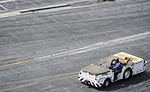 A U.S. Navy Aviation Boatswain's Mate (Handling) drives a tow tractor across the flight deck of the aircraft carrier USS Nimitz (CVN 68) Aug. 20, 2013, while underway in the Gulf of Oman 130820-N-TI017-034.jpg