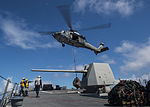 A U.S. Navy SH-60B Seahawk helicopter assigned to Helicopter Combat Support Squadron (HSC) 25 delivers cargo to the guided missile destroyer USS Preble (DDG 88) during a replenishment at sea in the Pacific Ocean 130819-N-HI414-056.jpg
