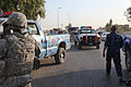 A U.S. Soldier provides security as Iraqi policemen with the local emergency services unit set up a traffic control point in Kirkuk province, Iraq, Aug 110801-A-YF193-034.jpg