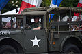 A U.S. veteran drives a vintage military vehicle in the 2013 National Memorial Day Parade in Washington, D.C., May 27, 2013 130527-A-AO884-183.jpg