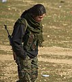 A YPJ fighter with her hands in her pockets.jpg