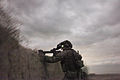 A coalition security forces member provides security during an operation in search of a Taliban leader in Dand district, Kandahar province, Afghanistan, March 28, 2013 130328-A-KM292-122.jpg