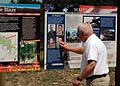 A family member of Modular Airborne Fire Fighting System 7(MAFFS-7) crew member U.S. Air Force Senior Master Sgt. Robert Cannon, touches an interpretive sign that was unveiled near Edgemont, S.D., July 1, 2013 130701-Z-BB320-002.jpg