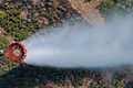 A helicopter bucket is used by a U.S. Army CH-47 Chinook helicopter crew assigned to the 2nd Battalion, 135th Aviation Regiment, Colorado Army National Guard to help fight the East Peak wildfire near La Veta 130621-Z-UA373-287.jpg