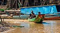 A man and his sons in a boat (Kampong Phluk, Cambodia).jpg