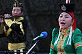 A member of the Mongolian Military Song and Dance Academic Ensemble performs a traditional song during a Mongolian culture event as part of exercise Khaan Quest 2013 at the Five Hills Training Area in Mongolia 130804-M-DR618-012.jpg