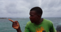 A motorboat operator in Sao Tome.png