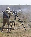 A soldier with the Ukrainian Land Forces fires a Degtyaryov-Shpagin Large-Caliber heavy machine gun.jpg