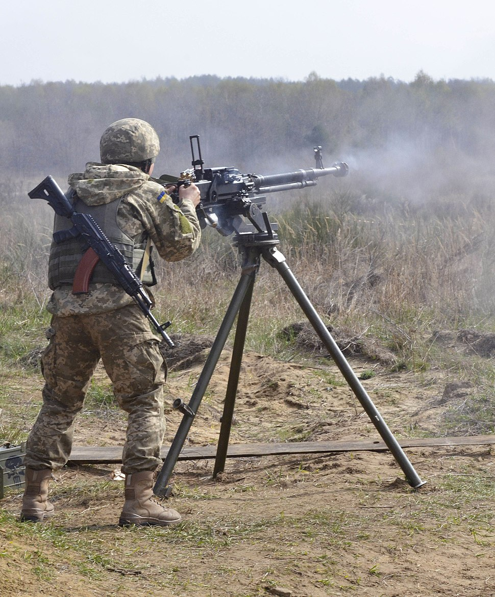 A soldier with the Ukrainian Land Forces fires a Degtyaryov-Shpagin Large-Caliber heavy machine gun