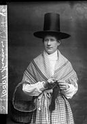 A woman in national dress and knitting (Thomas) NLW3362612.jpg