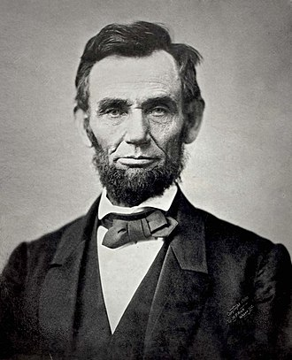 Iconic black and white photograph of Lincoln showing his head and shoulders.